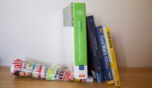 Image of textbooks on top of magazines